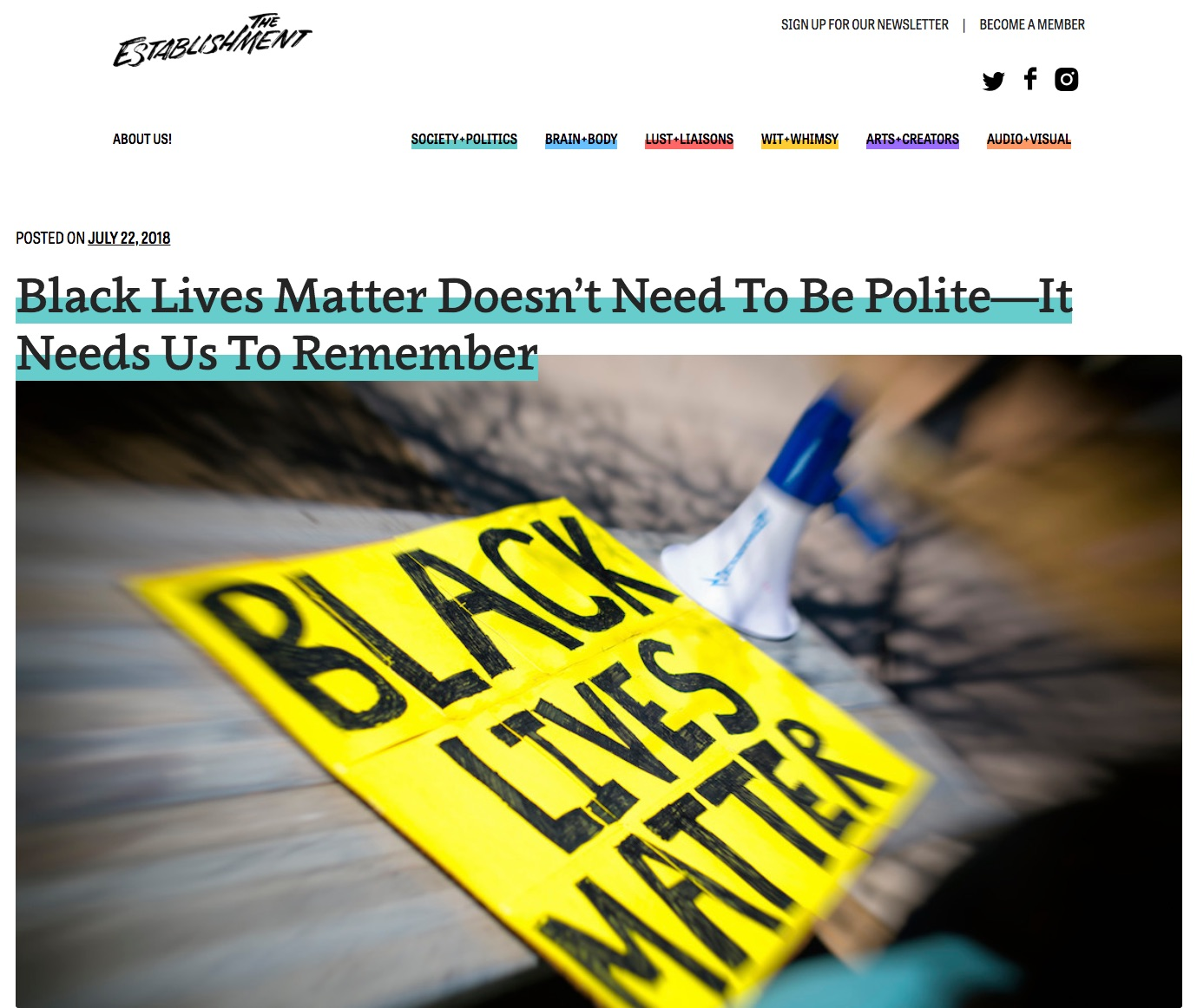 Screen shot of The Establishment's homepage, featuring a photo of a Black Lives matter sign lying on a sidewalk