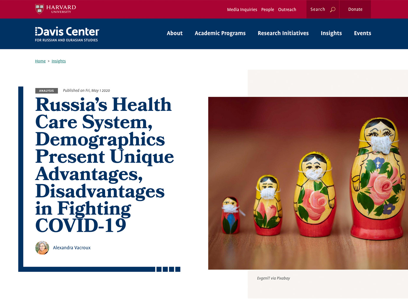 "Article headline: ""Russia's Health Care System, Demographics Present Unique Advantages, Disadvantages in Fighting COVID-19"" next to photo of Russian nesting dolls with handmade tiny pandemic facemasks on their faces"