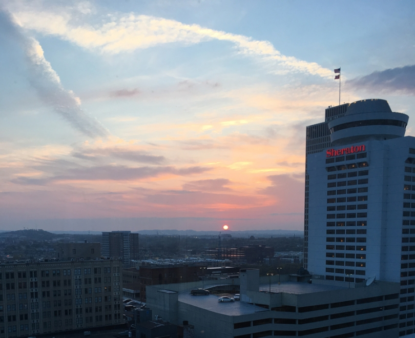 Sunset over Nashville, mountains in distance, looking out 20th floor past Sheraton hotel